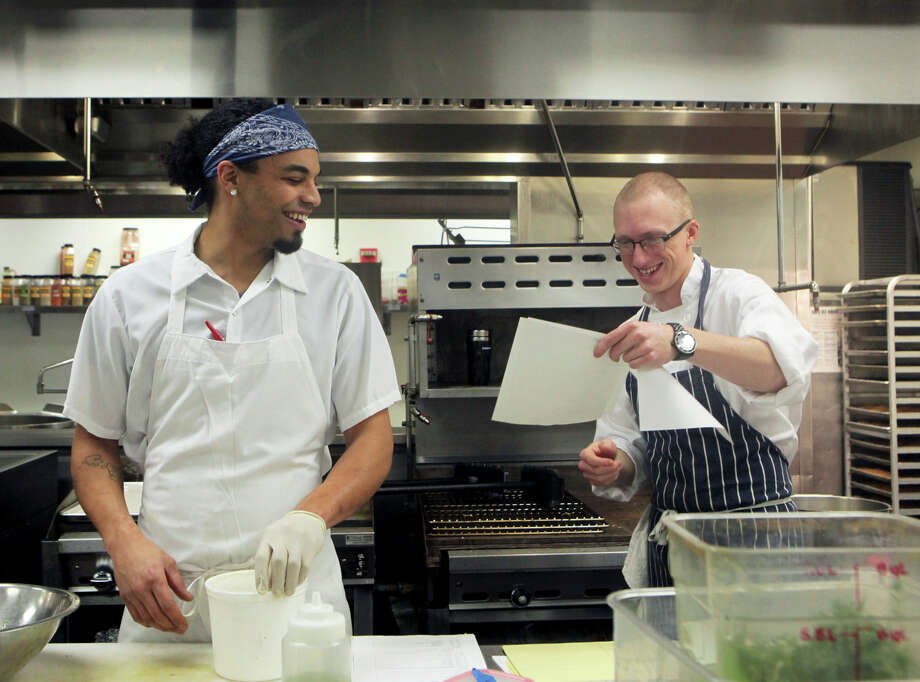 Sprig's Kitchen Manager Anthony Moore, left, shares a laugh. Photo: Santiago Mejia / The Chronicle / ONLINE_YES