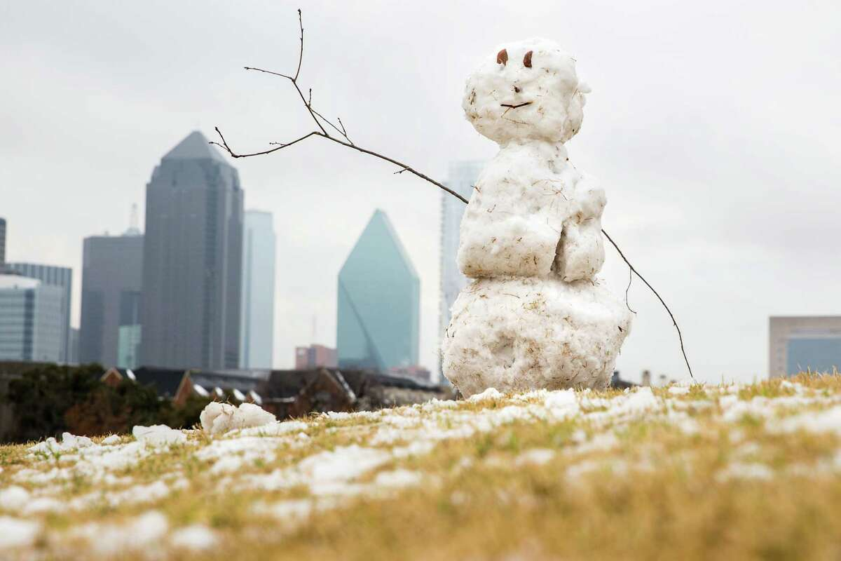 A snowman sits atop a small hill in Griggs Park near downtown Dallas after a winter storm dumped snow over North Texas, Wednesday, Feb. 25, 2015.