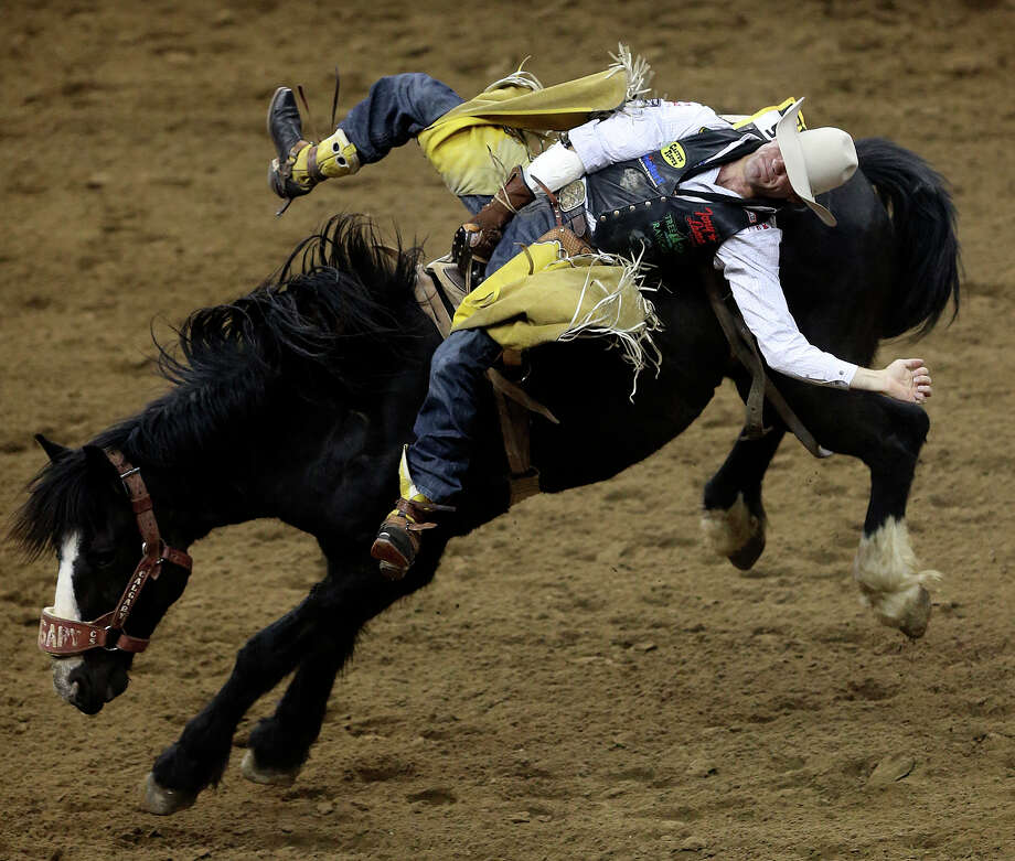 Bobby Mote, of Stephenville, Texas, rides to score an 85 in the bareback riding competition during the San Antonio Stock Show & Rodeo Semifinals second night of a two-night event, Wednesday, February 25, 2015. Mote tied for second in the event with Caleb Bennett of Tremonton, Utah. Photo: Jerry Lara /San Antonio Express-News / © 2015 San Antonio Express-News