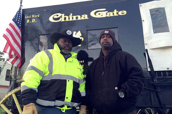 Kevin Joe, left, and Joshua Joe ride in the China Gate wagon, which their late father used for 30 years.