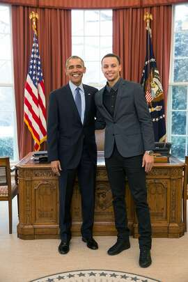 President Barack Obama poses with Warriors guard Stephen Curry in the Oval Office at the White House during Curry's visit on Wednesday.