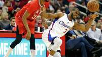The Rockets' Corey Brewer, left, gets rough with Chris Paul on Wednesday night. Brewer inflicted more pain on the Clippers by scoring 20 points.
