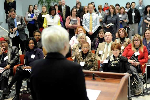 The audience, comprised of business men and women, educators and officials, listen to SUNY Chancellor Nancy Zimpher speak during a news conference to release the 2014 Albany Promise Report Card on Wednesday, Feb. 25, 2015, at UAlbany in Albany, N.Y. The report card offers an update on the progress being made to improve student achievement from cradle to career in the City of Albany. (Cindy Schultz / Times Union) Photo: Cindy Schultz / 00030748A