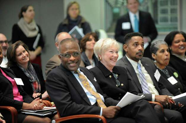 SUNY Chancellor Nancy Zimpher, center, and UAlbany president Robert Jones, to her left, react to a light moment during a news conference to release the 2014 Albany Promise Report Card on Wednesday, Feb. 25, 2015, at UAlbany in Albany, N.Y. (Cindy Schultz / Times Union) Photo: Cindy Schultz / 00030748A