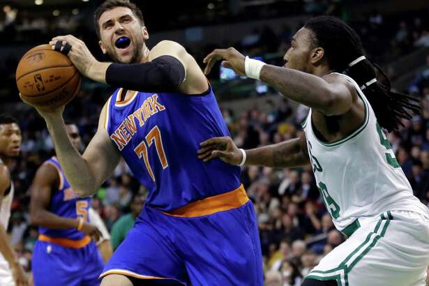 New York Knicks center Andrea Bargnani (77) makes a move against Boston Celtics forward Jae Crowder, right, during the first half of an NBA basketball game in Boston, Wednesday, Feb. 25, 2015. (AP Photo/Elise Amendola) ORG XMIT: MAEA101