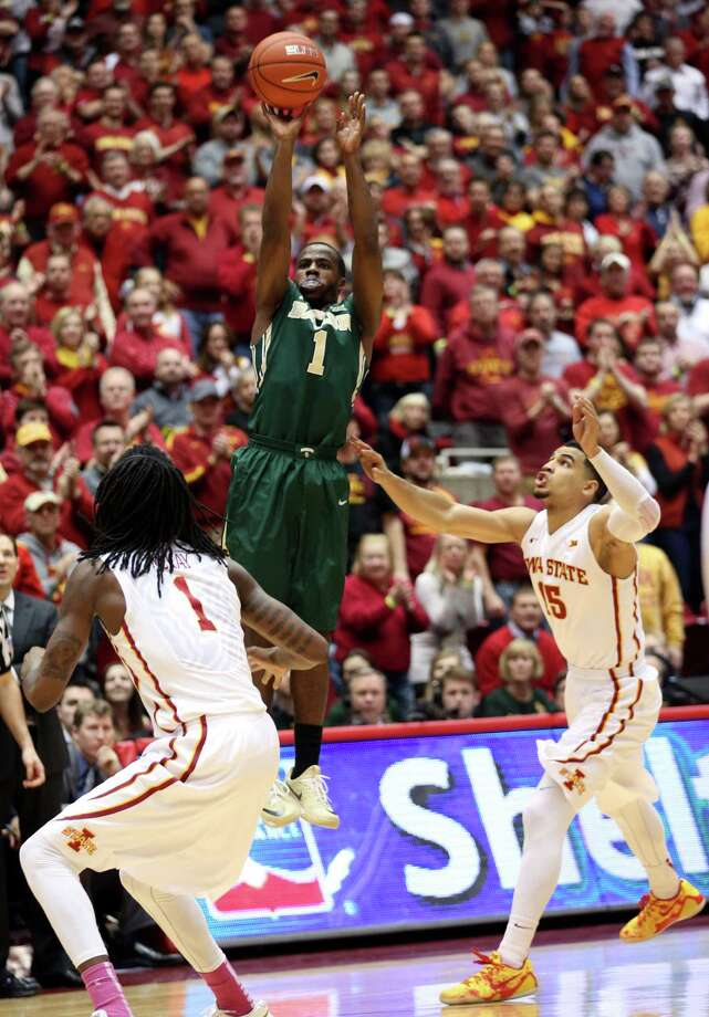 Baylor guard Kenny Chery shoots a 3-pointer over Iowa State forward Jameel McKay and guard Naz Long during the second half in Ames, Iowa. Photo: Justin Hayworth /Associated Press / FR170760 AP