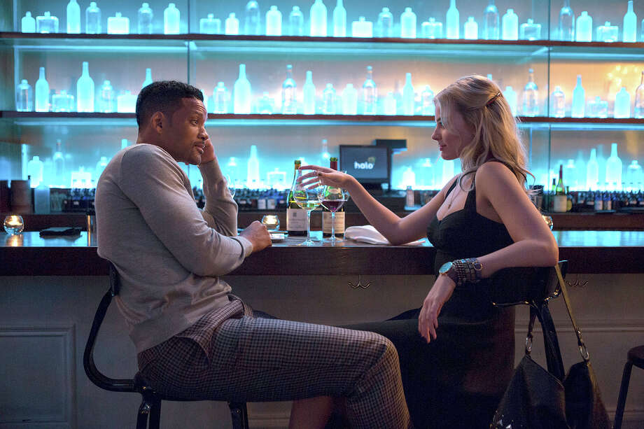 """Will Smith stars as Nicky and Margot Robbie as Jess in the heist film """"Focus."""" Illustrates FILM-FOCUS-ADV27 (category e), by Ann Hornaday © 2015, The Washington Post. Moved Wednesday, Feb. 25, 2015. (MUST CREDIT: Frank Masi/Warner Bros.) Photo: HANDOUT, STR / Washington Post / THE WASHINGTON POST"""