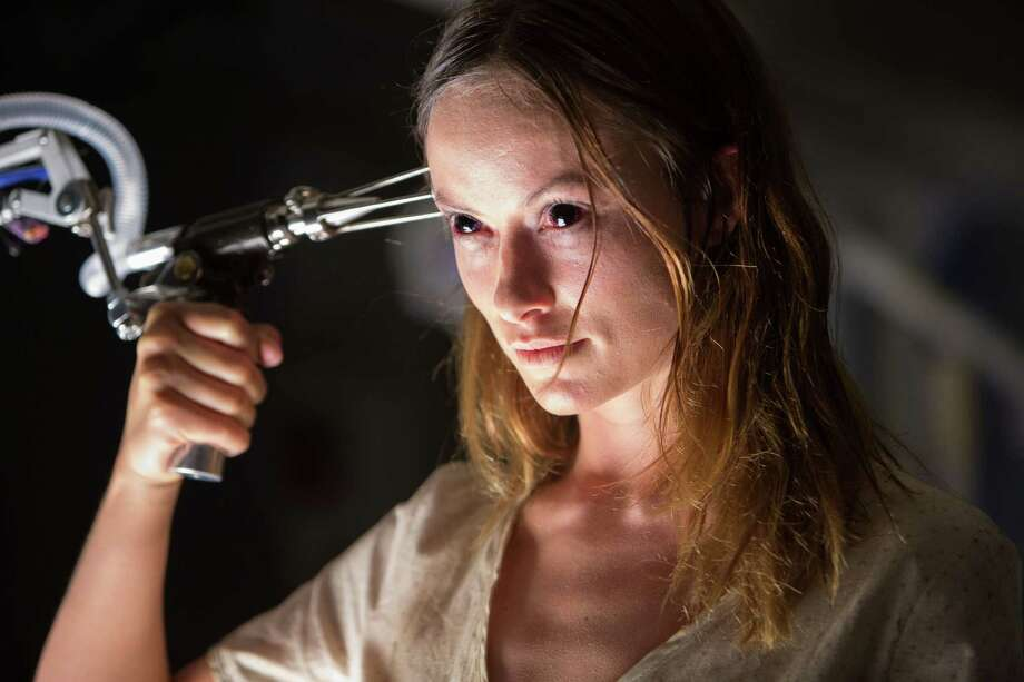 """In this image released by Relativity Media, Olivia Wilde appears in a scene from """"The Lazarus Effect"""". (AP Photo/Relativity Media, Daniel McFadden) Photo: Daniel McFadden, HONS / Associated Press / Relativity Media"""