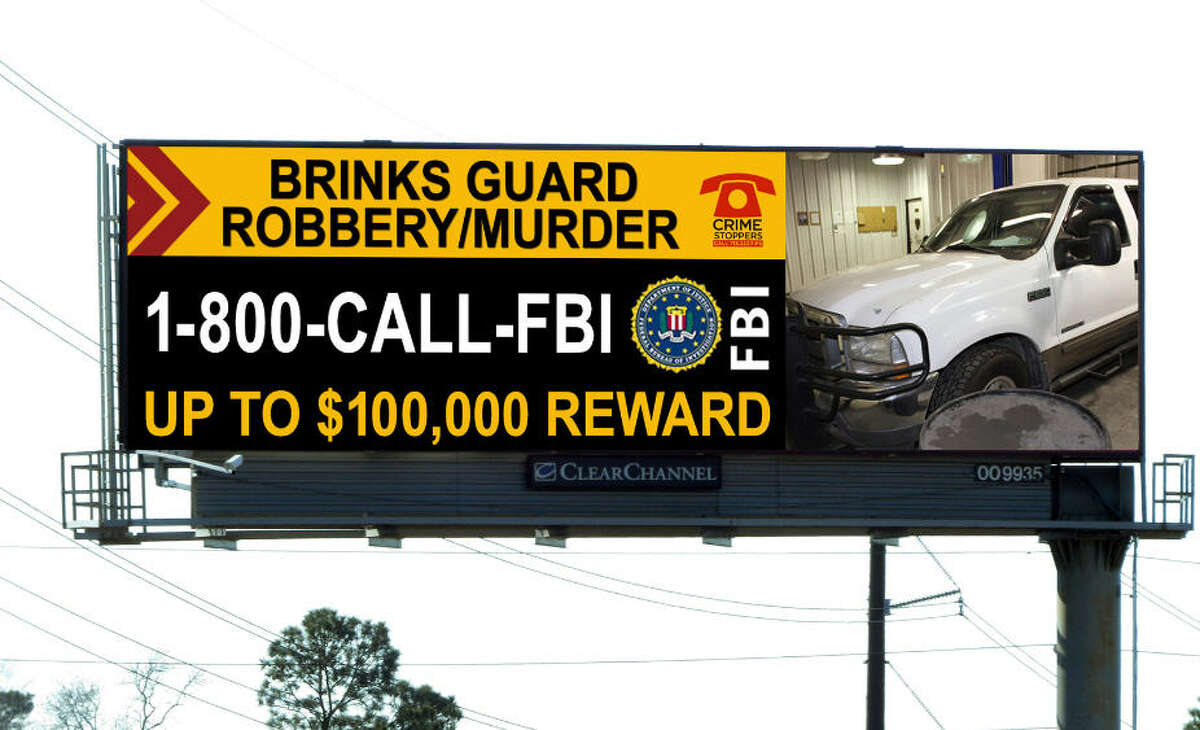 Digital Billboard displays a call for the public to help solve the slaying of a Brinks armored car guard Feb. 12 in Houston's Galleria area. The pick-up truck shown was used in the attack, according to authorities. The digital billboard, one of eight surrounding the Houston area that is delivering the message, is part of a partnership between Clear Channel Outdoor and the FBI.