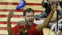Houston Rockets forward Donatas Motiejunas right, hugs teammate Rockets guard Corey Brewer left, is fouled during the fourth quarter of NBA game action against the Los Angeles Clippers at the Toyota Center Wednesday, Feb. 25, 2015, in Houston. ( James Nielsen / Houston Chronicle )