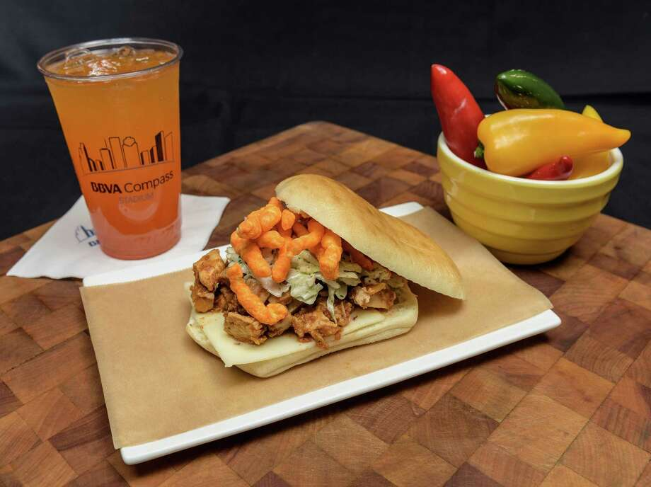 Cheetos Chicken Torta: Ancho marinated chicken, pepper jack cheese, jalapeno slaw and crunchy Cheetos on torta bread. It'€™s sloppy; take a few extra napkins. ($10, Sections 115, 134)  at  BBVA Compass Stadium Photo: Wilf Thorne / © Wilf Thorne