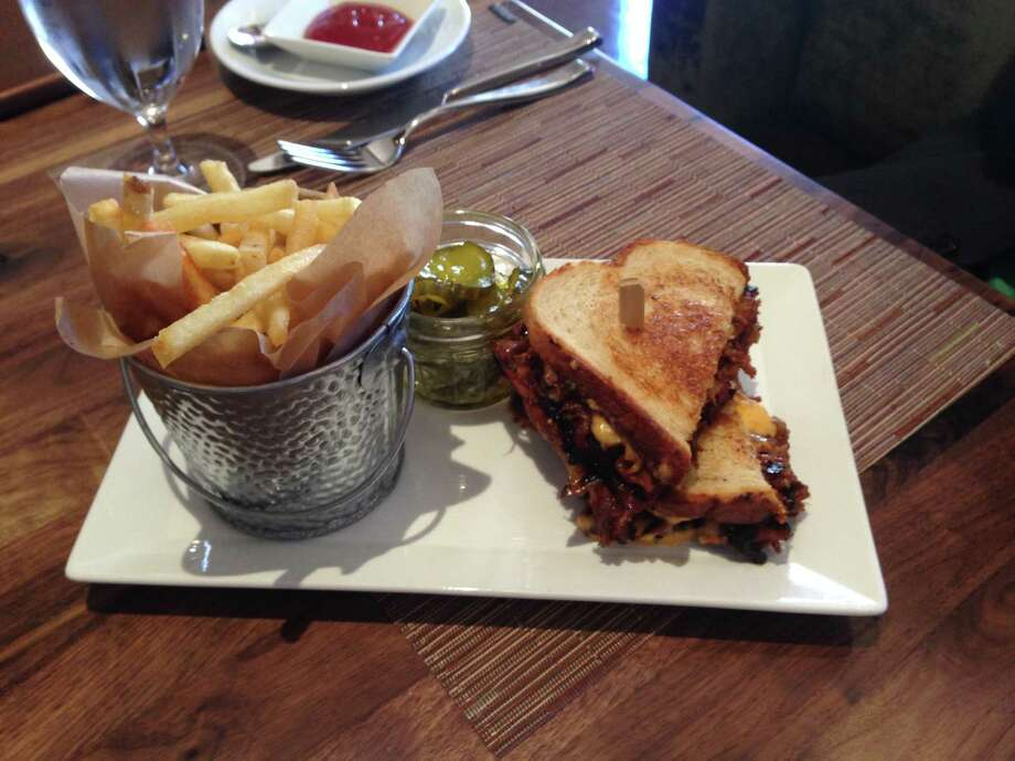 Wagyu brisket melt, with pimento cheese and caramelized onions on sourdough bread, served with fries and pickles Photo: Edmund Tijerina