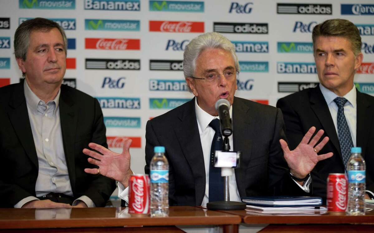 Mexico's Chivas President Jorge Vergara, left, Mexican Soccer Federation President Justino Compean, center, and Hector Gonzalez, the director of Mexico's national soccer teams, give a press conference in Mexico City, Friday, Oct. 18, 2013.