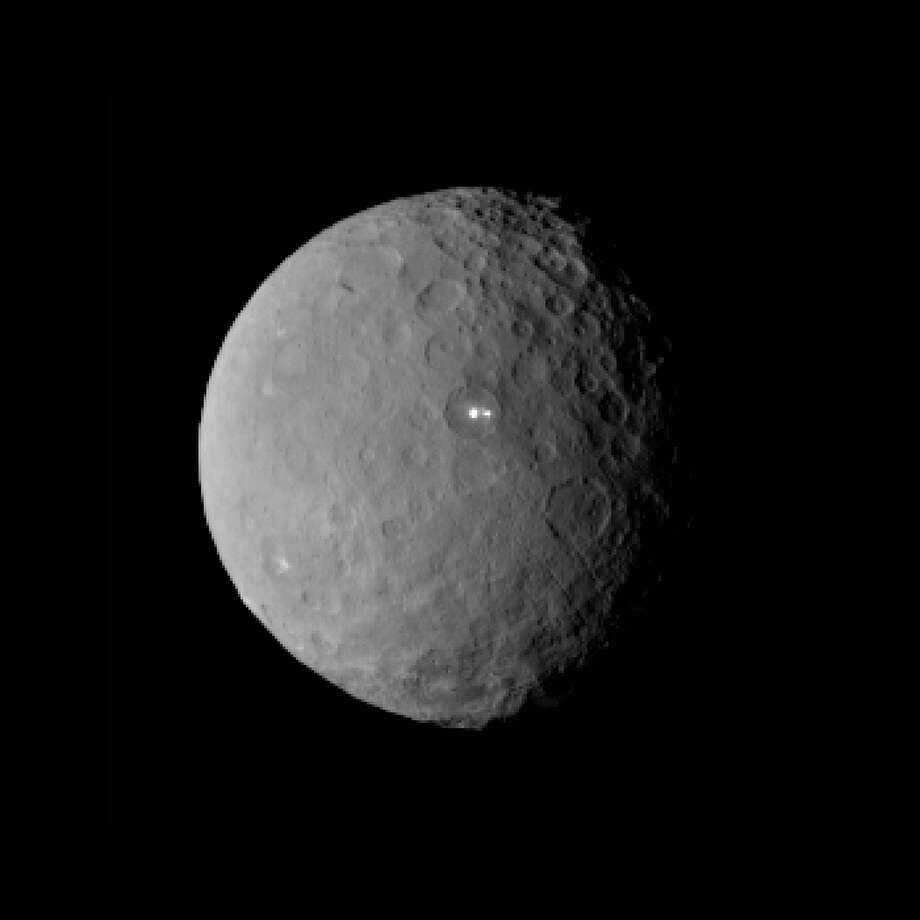 NASA's Dawn spacecraft launched in September 2007 with the goal of orbiting Ceres, the largest object in the asteroid belt. As the spacecraft has approached, its images have become sharper, revealing incredible finds even at distances of tens of thousands of miles. This image was taken by Dawn on Feb. 19 from a distance of nearly 29,000 miles (46,000 kilometers). The mysterious bright spots can be seen near the center of the dwarf planet.  Photo: NASA/JPL-Caltech/UCLA/MPS/ DLR/IDA