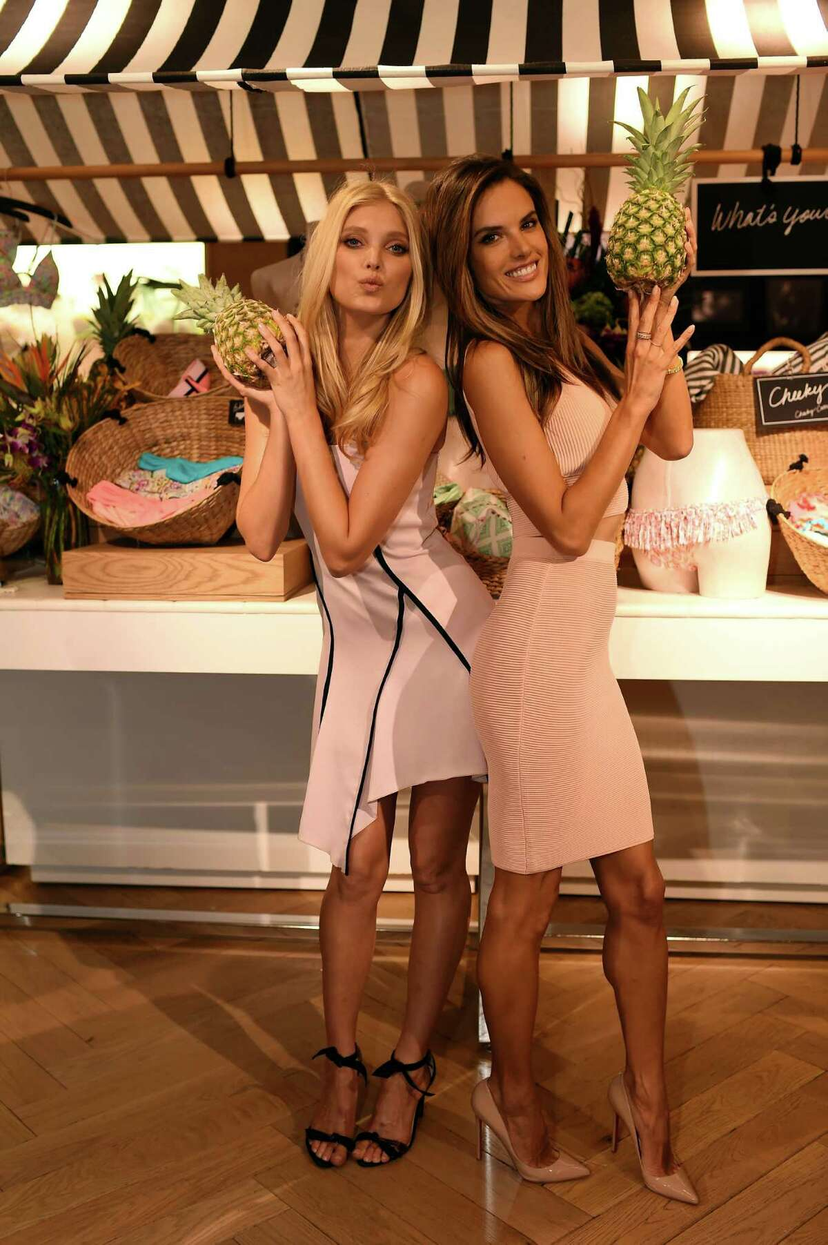Victoria's Secret Angels Elsa Hosk (L) and Alessandra Ambrosio celebrate the sexiest Push-ups and The Victoria's Secret Swim Special at Victoria's Secret Herald Square on February 25, 2015 in New York City.