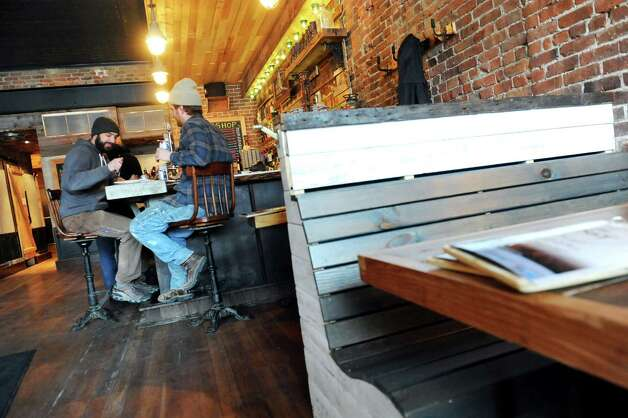 The bar and dining area on Thursday, Feb. 19, 2015, at The Shop in Troy, N.Y. (Cindy Schultz / Times Union) Photo: Cindy Schultz / 00030692A