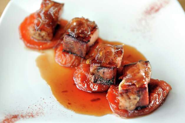 Crispy Pork Belly appetizer has house-cured, hardwood-smoked pork with bourbon sweet peach and red onion marmalade on Thursday, Feb. 19, 2015, at The Shop in Troy, N.Y. (Cindy Schultz / Times Union) Photo: Cindy Schultz / 00030692A