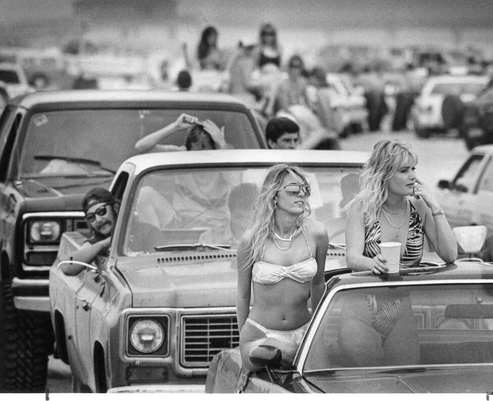It's spring break 1988, and Chris Vitale and Dina Boyle, both of San Antonio, check out the crowd on Mustang Island.