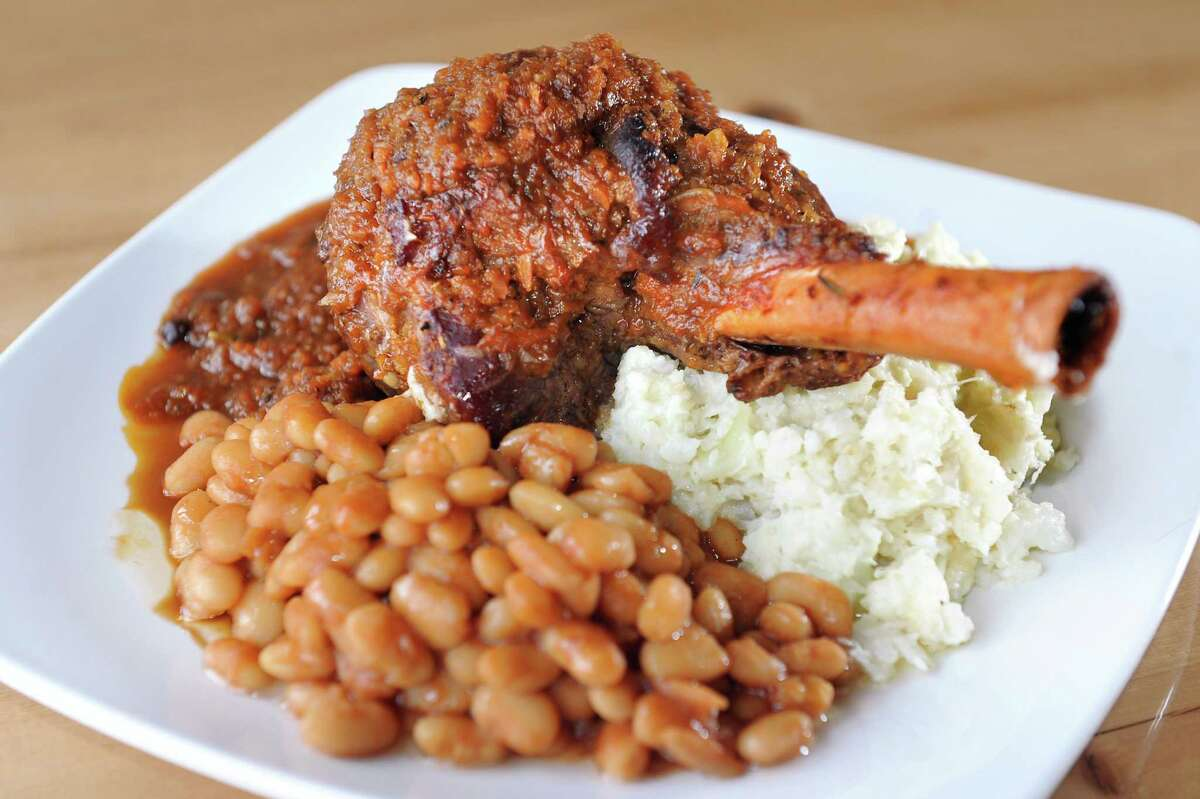 Lumberjack Stew has lamb shank, white beans and cauliflower gratin on Thursday, Feb. 19, 2015, at The Shop in Troy, N.Y. (Cindy Schultz / Times Union)