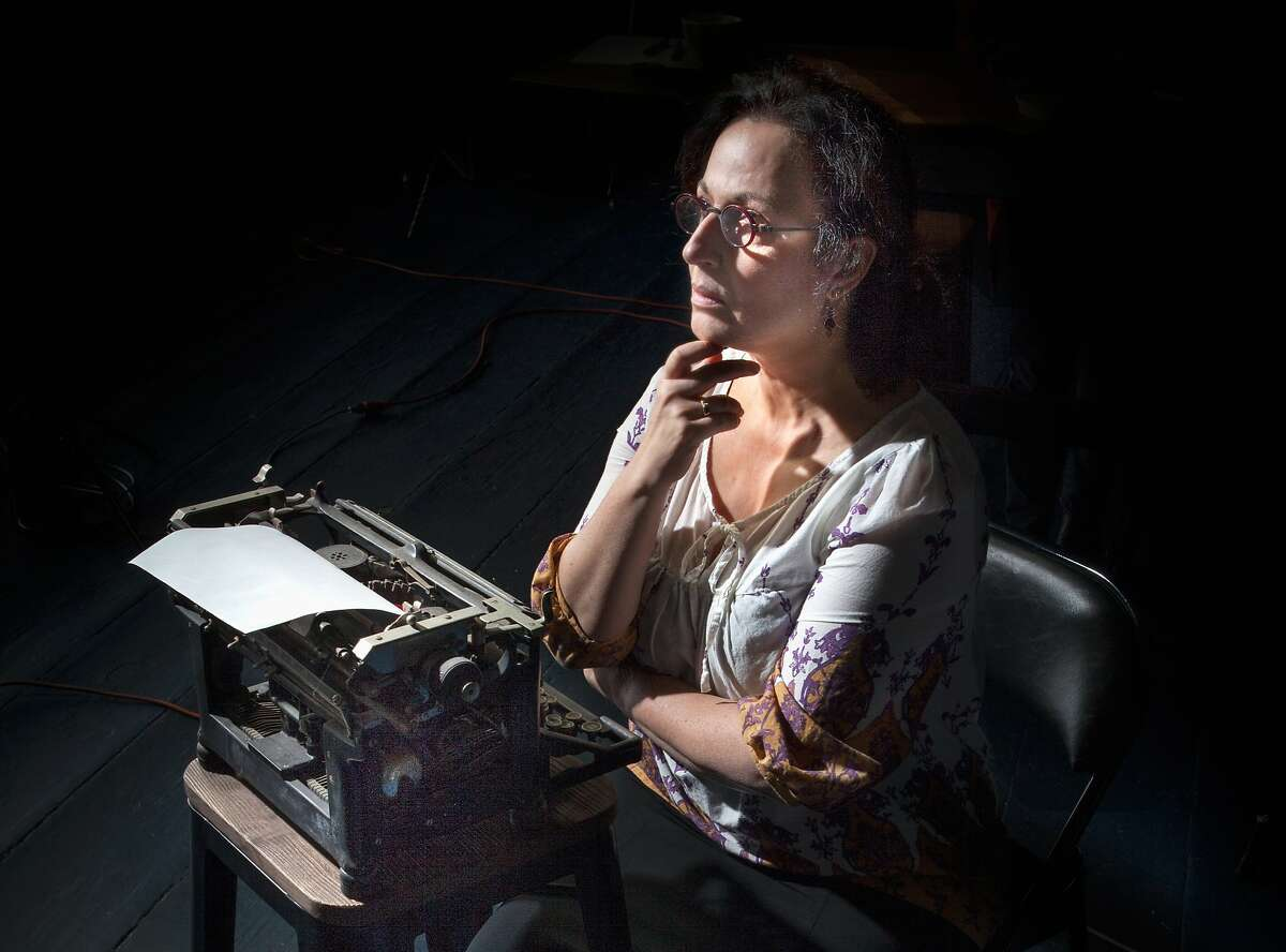 """Jeri Lynn Cohen in """"The Office"""" one of two Alice Munro short stories turned into fully staged pieces of theater by Word for Word. """"Stories by Alice Munro: 'The Office' and 'Dolly'"""" continues through April 12 at Z Below. Photo by Mark Leialoha"""