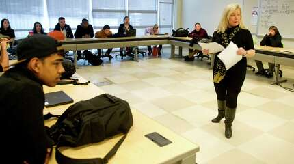 Teacher Brenda Zanga gives her students an assignment during their class about entrepreneurism at AITE in Stamford, Conn., on Thursday, February 26, 2015.