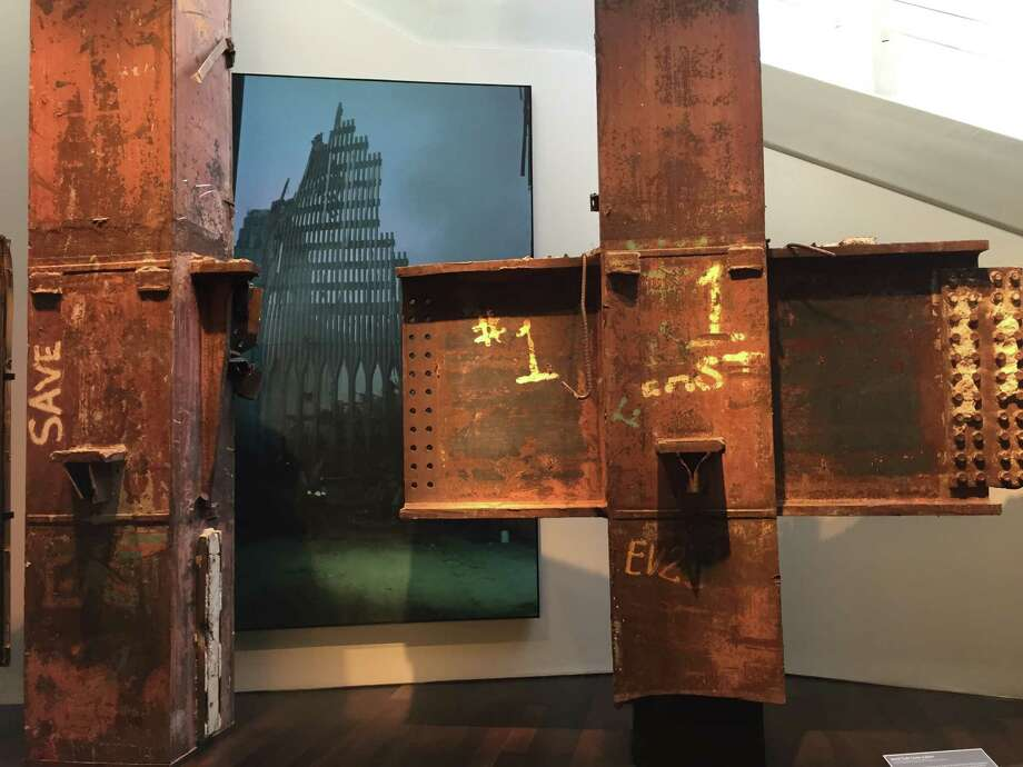 Steel columns recovered from ground zero are juxtaposed against a photo of the post-collapsed scene at the Sept. 11 museum. Photo: John Diaz / The Chronicle / ONLINE_YES