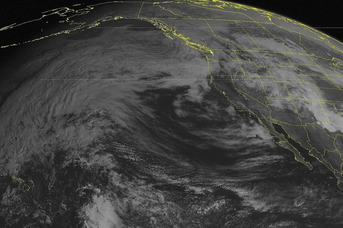 This NOAA satellite image taken Thursday, Feb. 26, 2015 at 1:00 p.m. EST, shows some scattered rain showers pushing into the Washington state coastline as a system from the Eastern Pacific Ocean is making its way onshore.