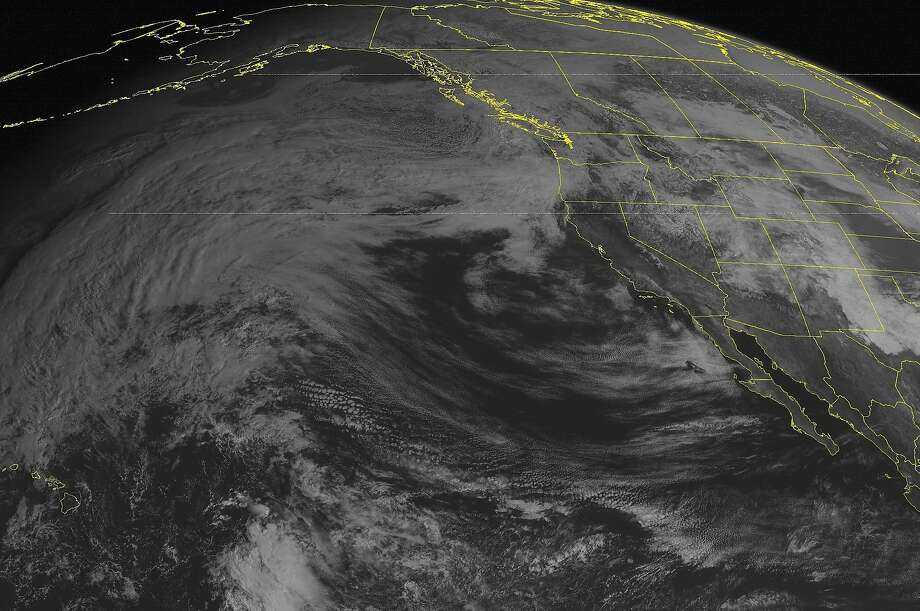 This NOAA satellite image taken Thursday, Feb. 26, 2015 at 1:00 p.m. EST, shows some scattered rain showers pushing into the Washington state coastline as a system from the Eastern Pacific Ocean is making its way onshore. Photo: Noaa, Associated Press