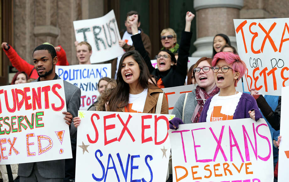 Participants chant as college students and abortion rights activists gather on the steps of the State Capitol to demonstrate for their cause on Feb. 26, 2015. Photo: Tom Reel, Tom Reel/	San Antonio Express-News