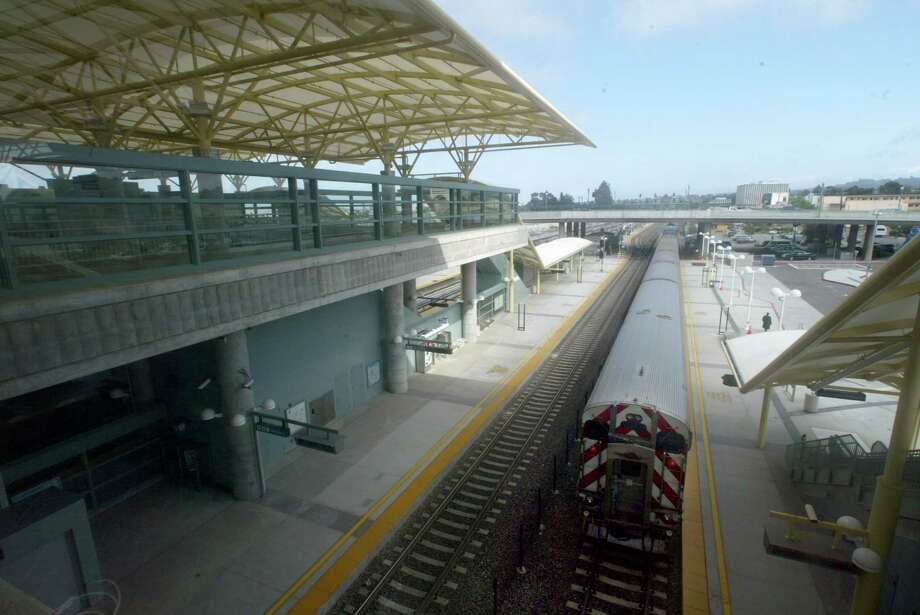 station220155_cs.jpg  Event on 6/17/03 in Millbrae.  A CalTrain passes through the new BART station in Millbrae.  BART will finally open its SFO connection, allowing travelers from San Francisco and the East Bay to reach the airport via rapid transit.   CHRIS STEWART / The Chronicle Photo: CHRIS STEWART / SFC / The Chronicle