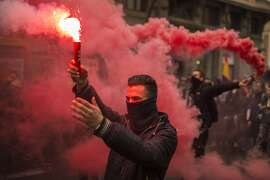Students march and light flares during the second day of student strike in Madrid, Spain Thursday Feb. 26, 2015. Students across Spain are protesting changes in the system of university degrees with protests and a two-day strike. (AP Photo/Andres Kudacki)