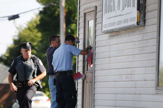 Code enforcement officials from the Town of Colonie post notice that the building at 470 Troy-Schenectady Road is closed to occupancy Friday afternoon, Sept. 19, 2014, in Colonie, N.Y.  The violations include structural, electric and plumbing issues. (Will Waldron/Times Union archive) Photo: WW / 00028702A