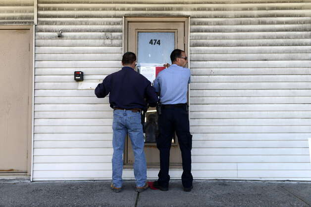 Code enforcement officials from the Town of Colonie post notice that the building at 470 Troy-Schenectady Road is closed to occupancy Friday afternoon, Sept. 19, 2014, in Colonie, N.Y.  (Will Waldron/Times Union archive) Photo: WW / 00028702A