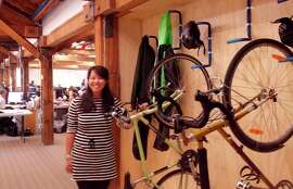Cindy Ma, an employee with KTGY Group, shows off indoor bike facilities she helped create.