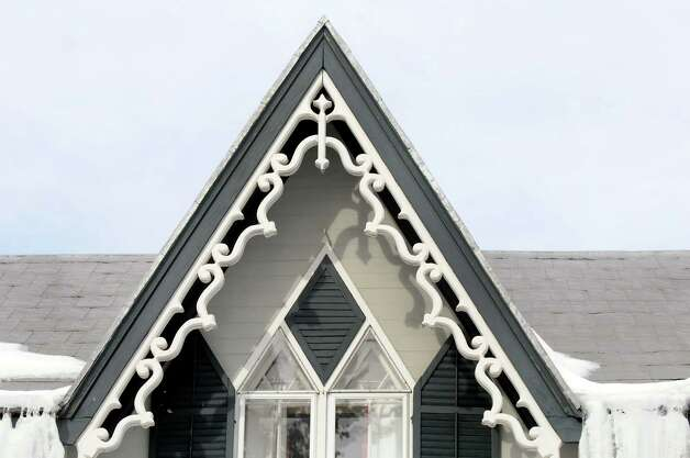 The calling card of this Gothic style home at 40 Church St., Coeymans is the steep gabled roof and elaborate vergeboards at the eaves. (Cindy Schultz / Times Union) Photo: Cindy Schultz / 00030728A