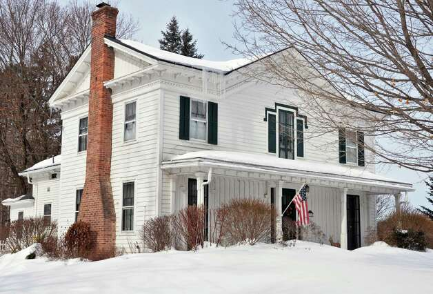 The Gothic details are subtle on the Asa Clark House, circa 1845, at 394 Vischer Ferry Road in Clifton Park. Gothic features include the front gable over the porch and the wood lintel over the center second-story window, as well as the vertical board and batten siding on the first floor, which was common on wooden Gothic houses. (John Carl D'Annibale / Times Union) Photo: John Carl D'Annibale / 00030728B