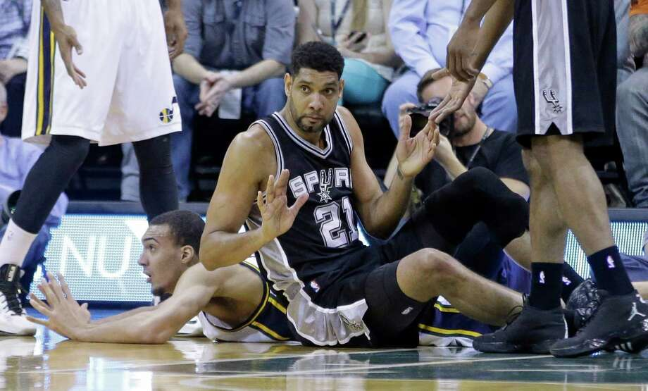 San Antonio Spurs forward Tim Duncan finds himself on the floor after a collision with Utah Jazz center Rudy Gobert during the first quarter of their game Monday in Salt Lake City. The Spurs have stumbled as a team as well, but a reader says it is just the rest of the league catching up. Photo: Rick Bowmer /Associated Press / AP