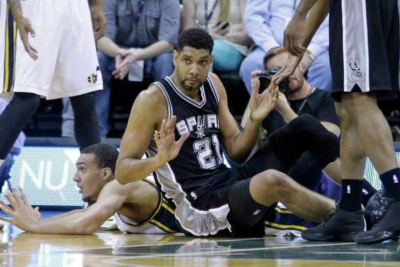 San Antonio Spurs forward Tim Duncan finds himself on the floor after a collision with Utah Jazz center Rudy Gobert during the first quarter of their game Monday in Salt Lake City. The Spurs have stumbled as a team as well, but a reader says it is just the rest of the league catching up.