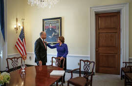 Homeland Security Department chief Jeh Johnson meets with House Minority Leader Nancy Pelosi in her Capitol Hill office.