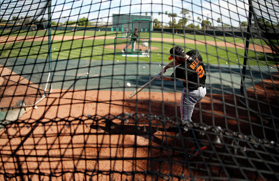 San Francisco Giants' Brandon Belt takes a cut in a batting cage in Scottsdale, Ariz., on Wednesday. Photo: Scott Strazzante / The Chronicle / ONLINE_YES
