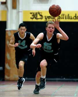 Burton's Clayton Ladine heads upcourt during a game last week in which he had 40 points, only a bit above his average.