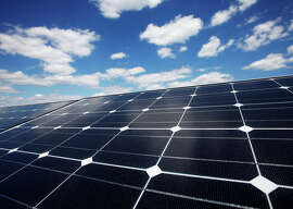 Solar panels line the roof of the Ikea store in Brooklyn, N.Y. SolarCity will use the money it gets from Google to finance installation of residential arrays that are leased to customers rather than sold.