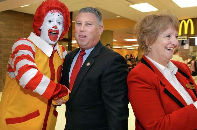 McDonald's ambassador of fun, Ronald McDonald, left, with Assemblyman John McDonald, no relation, and McDonald's Owner/Operator Kathie Reeher, right, during grand re-opening ceremonies for the McDonald's at Empire State Plaza Celebrates Thursday, Feb. 26, 2015, in Albany, N.Y.  (John Carl D'Annibale / Times Union) Photo: John Carl D'Annibale / 00030726A