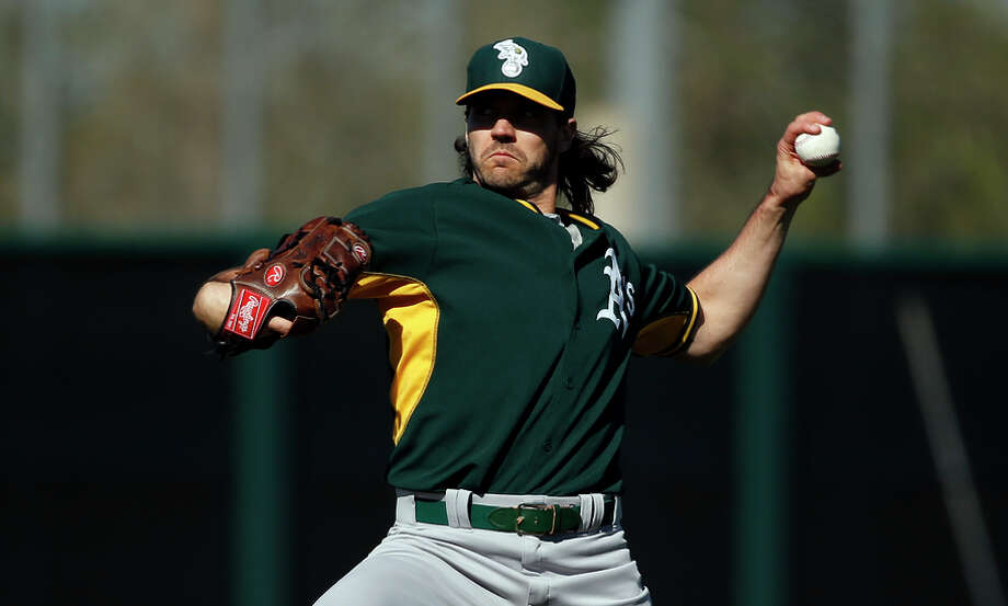 Barry Zito throws during spring training in Mesa, Ariz. At 37, he's attempting to earn a spot in the A's starting rotation. Photo: Scott Strazzante / The Chronicle / ONLINE_YES