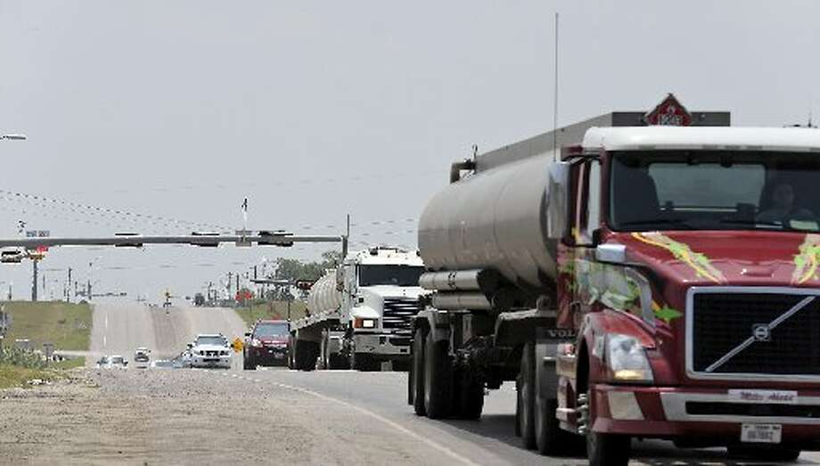 18-wheelers and other vehicles drive on U.S. Highway 181 Sunday July 20, 2014 in Karnes City. (Edward A. Ornelas/San Antonio Express-News)
