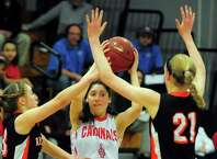 Greenwich's Leigh Galletta, center, is pressured by Ridgefield's Jessica Camarda, left, and Rebecca Lawrence, as she tries to pass the ball, during FCIAC Girls' Basketball Championship action in Fairfield, Conn. on Thursday Feb. 26, 2015.