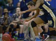 New Fairfield's Emily Farrell (2) and Notre Dame's Gabrielle Joseph (21) chase down a loose ball during the 1st half of the SWC Girls Basketball Championship Game between Notre Dame - Fairfield and New Fairfield high schools, played at Newtown High School, Newtown, Conn, on Thursday night, February 26, 2015.