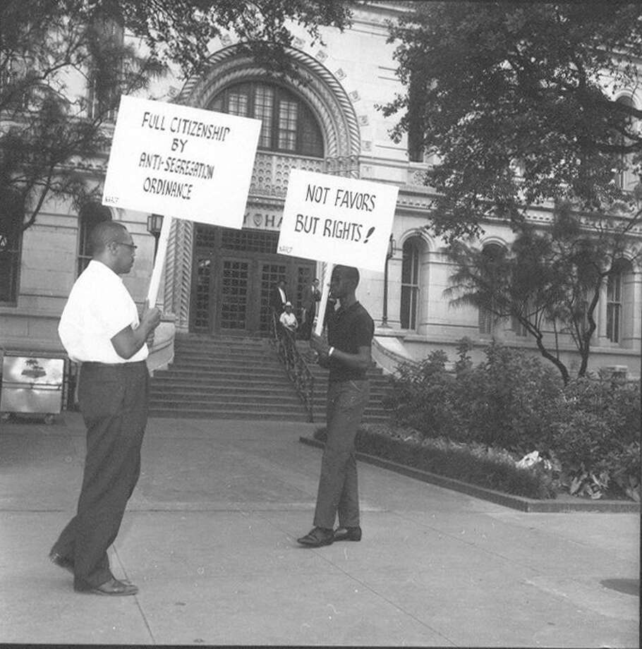 Harry V. Burns (left) and another man protest segregation at City Hall on June 12, 1963. Photo: Courtesy UTSA Special Collections / San Antonio Light Collection