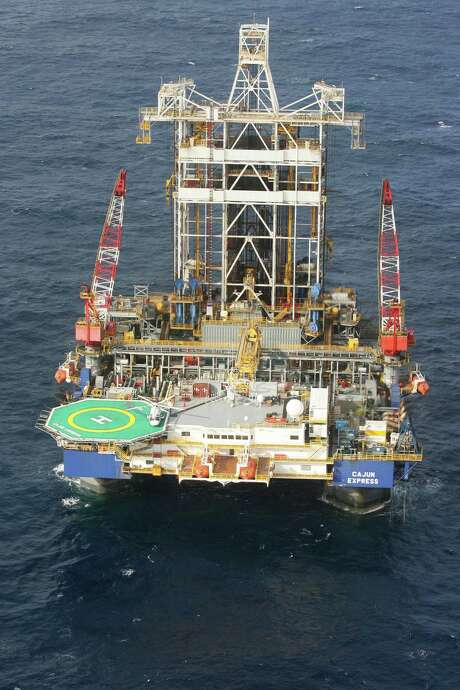 Cajun Express, a Transocean semisubmersible deepwater drilling oil rig, is seen from the air in this 2006 photo. Officials at Transocean, an offshore driller, said nine of its ultra-deep-water rigs will be available for new contracts this year but face stiff competition amid the oil price collapse. Executives said they'll waste no time mothballing top-of-the-line deep-water rigs if low oil prices keep them idle. Photo: Bloomberg News File Photo