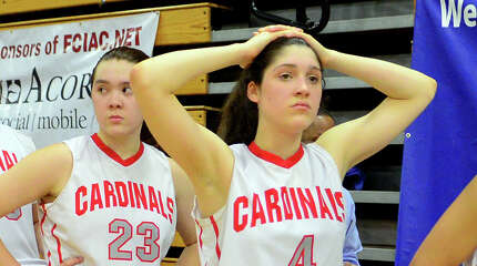 Greenwich team members stand stunned after losing to Ridgefield, during FCIAC Girls' Basketball Championship action in Fairfield, Conn. on Thursday Feb. 26, 2015.